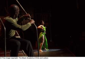 Primary view of object titled '[Performer in green dress dancing]'.