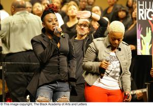 Primary view of object titled '[Chrisette Michele and Ledisi singing on stage]'.