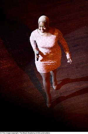 Primary view of object titled '[Chrisette Michele walking on stage]'.
