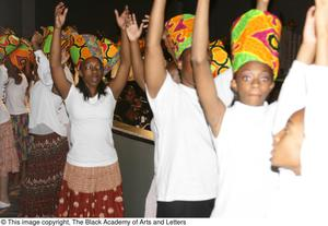 Primary view of object titled '[Group of Performers Raising Arms on Stage]'.