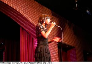 Primary view of object titled '[Rachel Webb singing on stage]'.