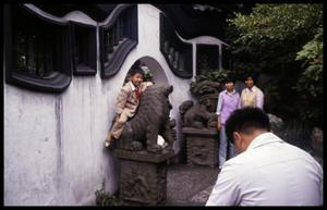 Primary view of object titled '[Boy on Lion Statue]'.