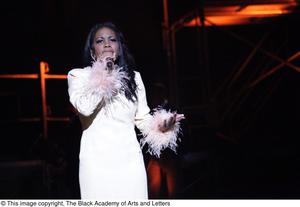 Primary view of object titled '[Actress performs solo in Aretha: The Musical]'.