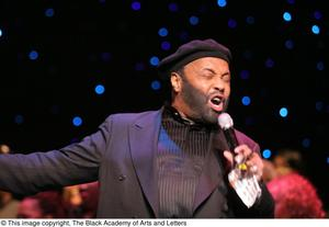 Primary view of object titled '[Andraé Crouch singing onstage]'.