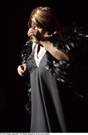 Primary view of object titled '[Singer with a black feather boa]'.
