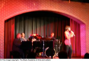 Primary view of object titled '[Rachel Webb singing in front of band]'.