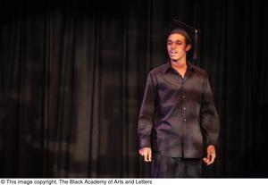 Primary view of object titled '[Unidentified Performer Wearing Graduation Cap]'.