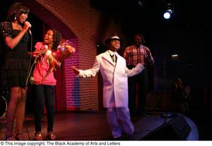 Primary view of object titled '[Kirondria Woods, Rachel Webb, boy in white suit, and Curtis King on stage]'.
