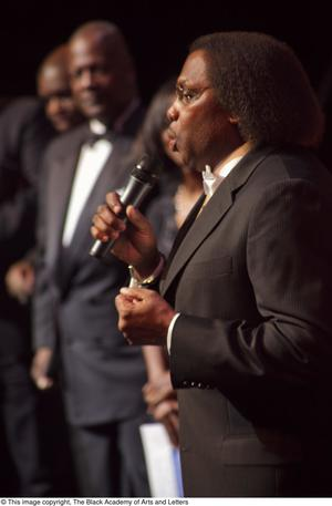 Primary view of object titled '[Curtis King speaking on stage]'.