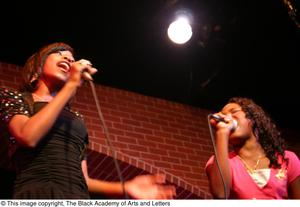 Primary view of object titled '[Kirondria Woods and Rachel Webb singing on stage]'.