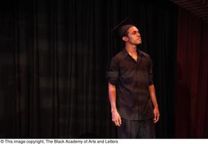 Primary view of object titled '[Performer Wearing Graduation Cap]'.