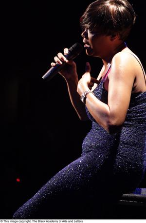 Primary view of object titled '[Singer in a sparkly dress]'.
