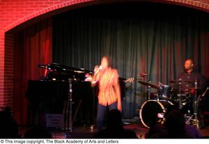 Primary view of object titled '[Kirondria Woods singing on stage]'.