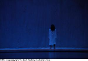 Primary view of object titled '[Dancer in white against blue backdrop]'.