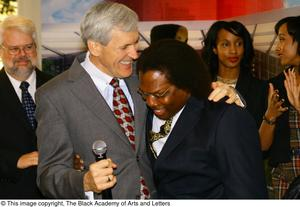 Primary view of object titled '[Curtis King hugs guest]'.
