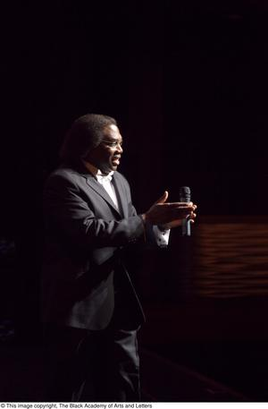 Primary view of object titled '[Curtis King clapping on stage]'.