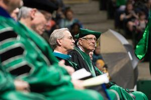 Primary view of [Seated members of the UNT Faculty on stage during commencement]