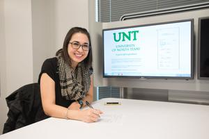 Primary view of object titled '[Woman Smiling for Photo at UNT's New College]'.