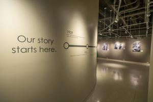 "Primary view of object titled '[""Our story starts here"" A Century of Excellence exhibit]'."