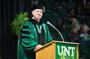 Primary view of object titled '[Faculty Member Standing At Podium During Commencement Ceremony]'.