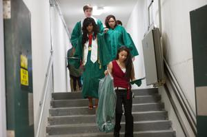 Primary view of object titled '[Undergraduate Students Getting Ready for Commencement Ceremony]'.
