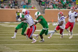 Primary view of object titled '[North Texas Football player defends teammate]'.