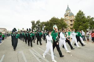 Primary view of object titled '[Green Brigade Marching Band in Homecoming Parade]'.