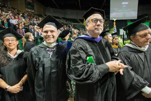 Primary view of object titled '[Faculty Members at the 2015 Winter Commencement Ceremony]'.
