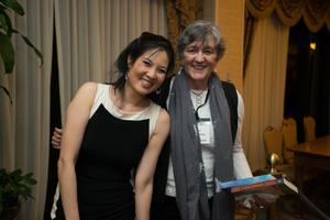 Primary view of object titled '[Sheryl WuDunn standing with a conference attendee]'.