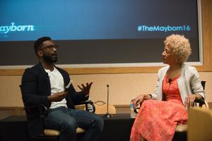 Primary view of object titled '[Wesley Morris and Margo Jefferson sitting at front of conference room]'.