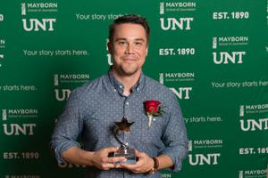 Primary view of object titled '[Ryan Durr holding up his award]'.