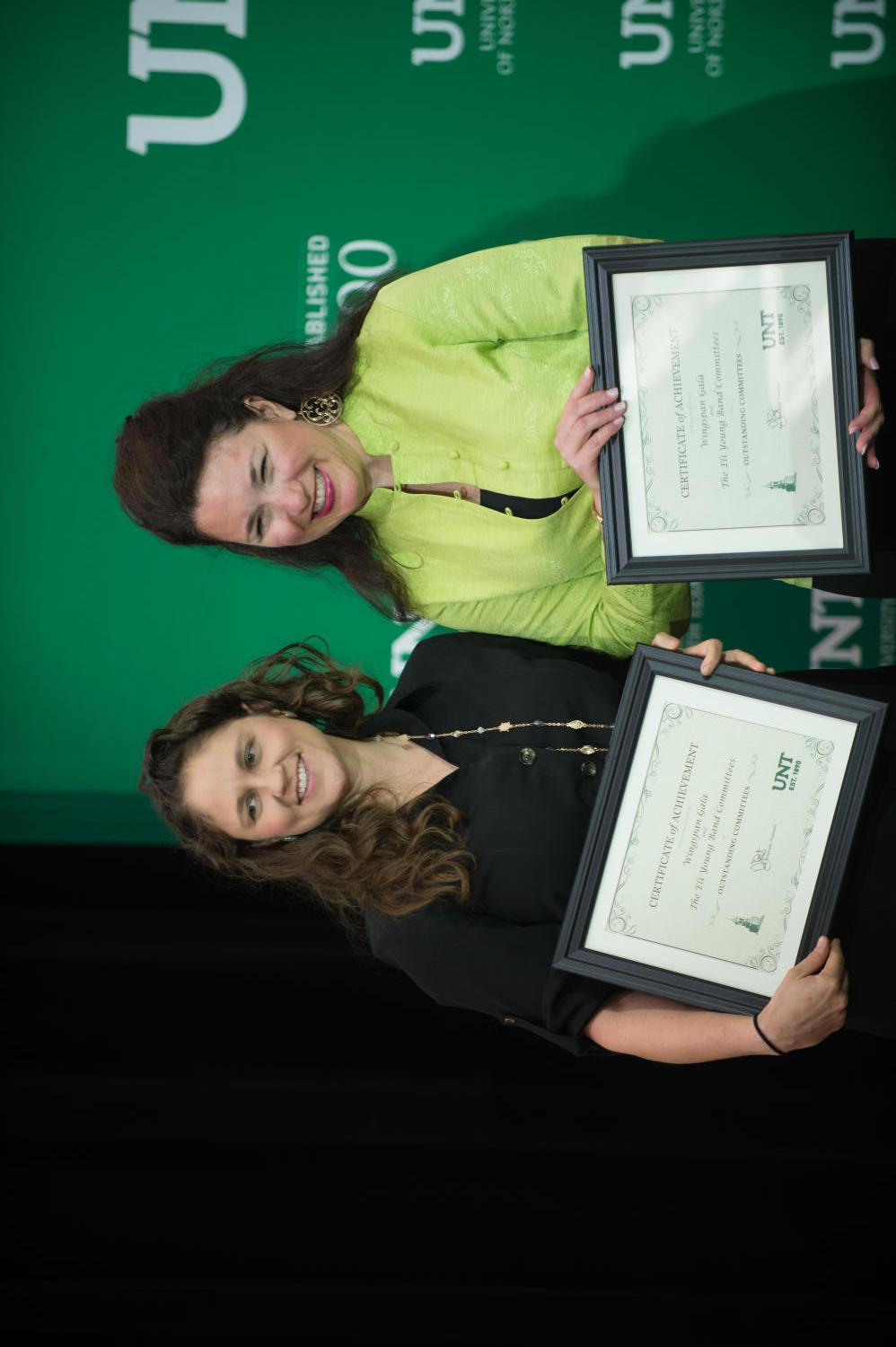 [Two women receiving Certificate's of Achievement]                                                                                                      [Sequence #]: 1 of 1