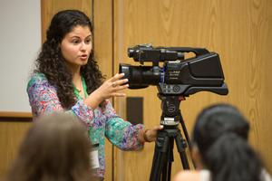 Primary view of object titled '[Andrea Czobor teaching students how to use broadcast cameras]'.