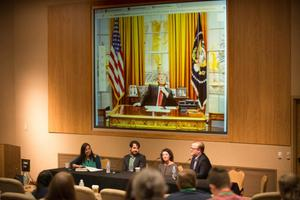"Primary view of object titled '[Panel of speakers at the ""Piñatas, Presidents and Pack Journalism"" event]'."