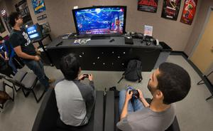 Primary view of object titled '[Students playing video games during International Game Day event]'.