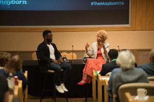 Primary view of object titled '[Margo Jefferson and Wesley Morris sitting at head of conference room]'.