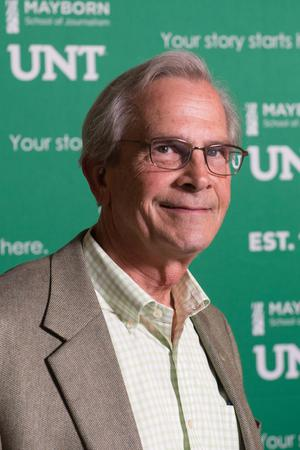 Primary view of object titled '[UNT System Chancellor Lee Jackson in front of Mayborn backdrop]'.