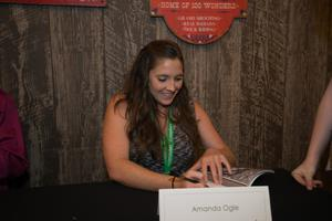 Primary view of object titled '[Amanda Ogle signing book]'.