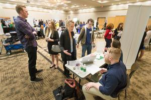 Primary view of object titled '[People engaging with one another at Career Fair]'.