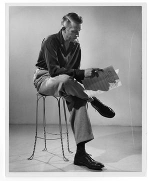 Primary view of object titled '[Stan Kenton Reading a Score]'.