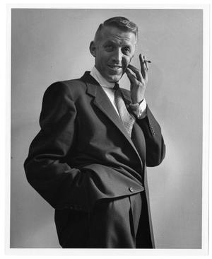 Primary view of object titled '[Photograph of Stan Kenton Smoking]'.