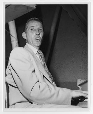 Primary view of object titled '[Photograph of Stan Kenton at the Piano]'.