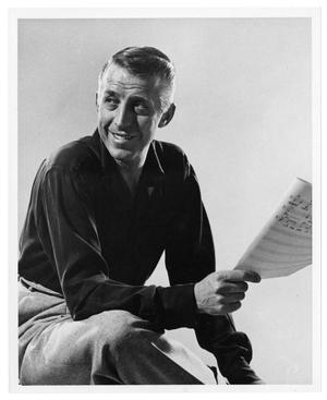Primary view of object titled '[Photograph of Stan Kenton with a Score]'.