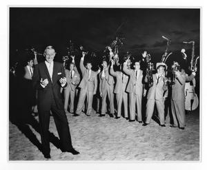 Primary view of object titled '[Photographs of Stan Kenton and Orchestra on Beach]'.