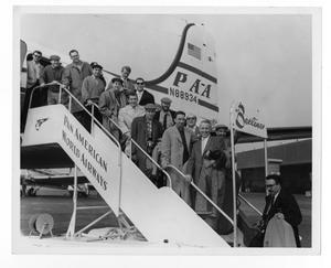 Primary view of object titled '[Photograph of Stan Kenton and Orchestra Boarding a Plane]'.