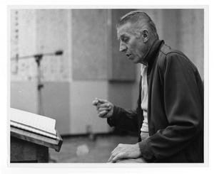 Primary view of object titled '[Photograph of Stan Kenton and Score]'.