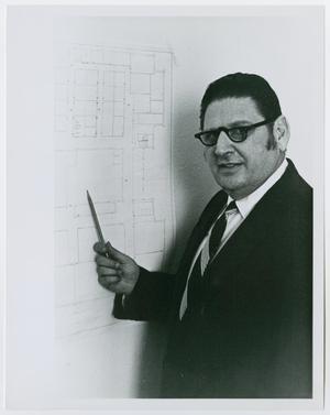 [Portrait of Dr. Hiram Friedsam Pointing at a Floorplan]