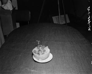 Primary view of object titled '[Bowl of dessert on a plate]'.