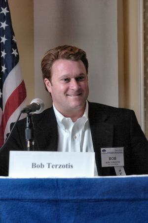 Primary view of object titled '[Bob Terzotis speaking into microphone during panel]'.