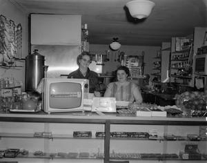 Primary view of object titled '[Two women behind store counter]'.